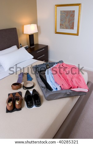 Opened travel bag with clothes - stock photo