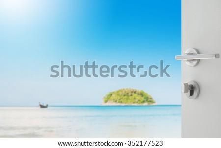 opened white door to beautiful seascape with blue sea beach island and the long tail boat under clear sky in summer,kata beach - phuket - stock photo