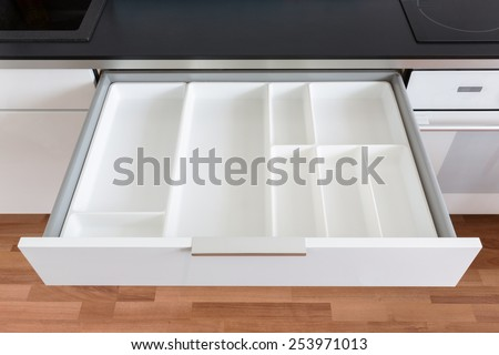 opened white empty drawer - stock photo