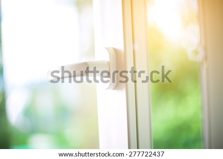 Opened white plastic window with sunlight. - stock photo