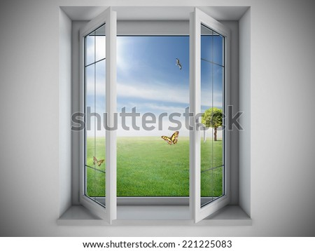 Opened window with a green field outdoor - stock photo