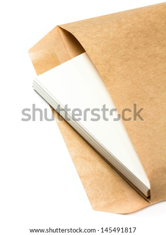 Opened yellow  Recycled kraft  envelope with paper letters inside on white background, closeup - stock photo