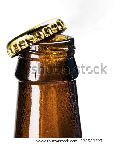 Opening a bottle of beer and foam on a white background - stock photo