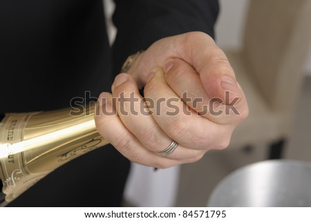 Opening a bottle of Champagne - stock photo