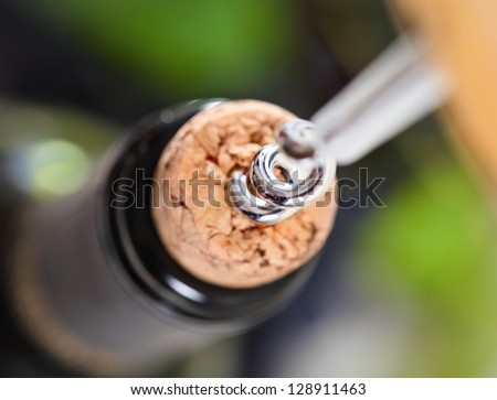 Opening a bottle of wine in celebration. Close up - stock photo