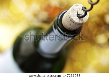 Opening a wine bottle with a corkscrew in a restaurant - stock photo