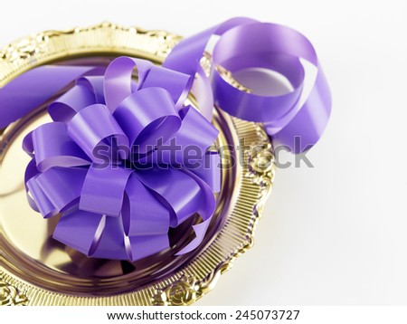 opening ceremony concept- purple ribbon bow on the golden plate - stock photo