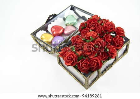 opening Chocolate boxes with  roses on white background, isolated - stock photo