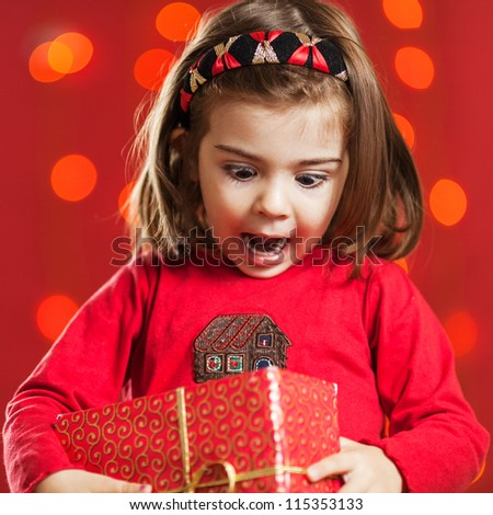 Opening Christmas gifts - stock photo