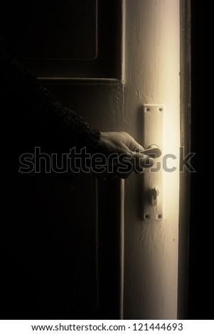 Opening door into mystical room. - stock photo