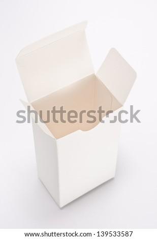 opening empty white paper box - stock photo