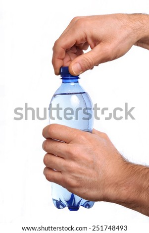 Opening mineral water plastic bottle. - stock photo