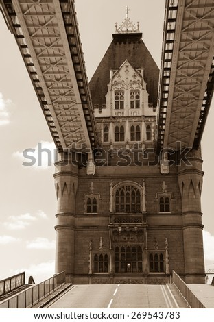 Opening of  the Tower Bridge in sunny day. London, England. Closeup. Aged photo. Sepia. - stock photo