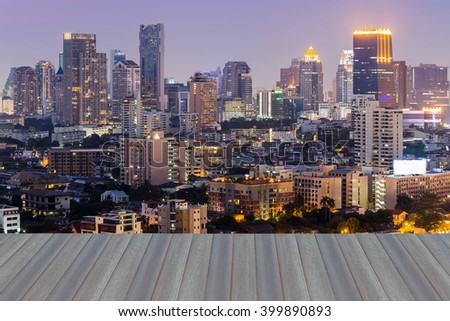 Opening wooden floor, Bangkok city downtown with dramatic sky during sunset - stock photo
