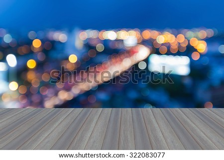 Opening wooden floor, Blur bokeh lights expressway curved during twilight  - stock photo