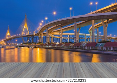 Opening wooden floor, Suspension bridge and overpass ring road during twilight, Bangkok Thailand - stock photo