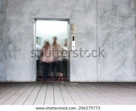 openning door of elevator and people walk out - stock photo