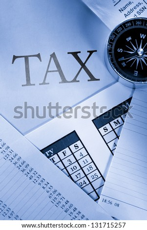 Operating budget, calendar, stopwatch and tax - stock photo