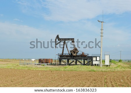Operating oil and gas well in desert - stock photo