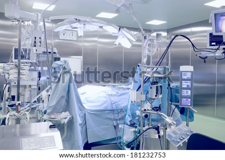 operating room with patient.  - stock photo