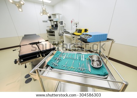 Operating room with surgical equipment - stock photo