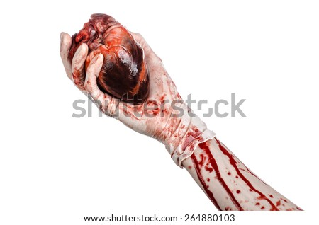 Operation and medicine theme: Bloody hand surgeon holding a human heart in a bloody white gloves isolated on a white background in studio - stock photo