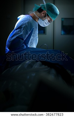 Operation being done on a patient in an operating                     - stock photo