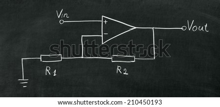 Operational amplifier circuit drawn on the blackboard with chalk - stock photo