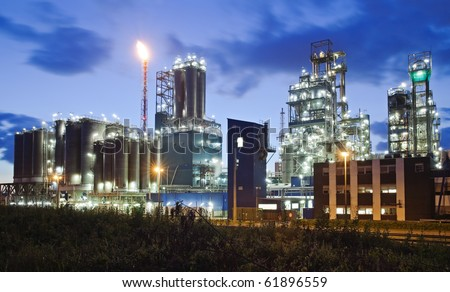 Operational petrochemical plant in twilight (Anwerp port, Belgium) - stock photo