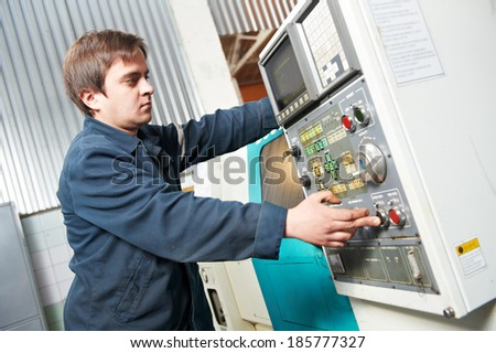 operative worker near cnc milling machine center at factory tool workshop - stock photo