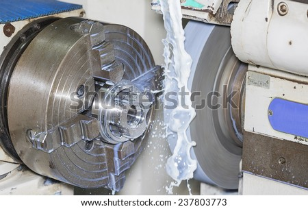 operator grinding mold and die part by universal grining machine in factory_01 - stock photo
