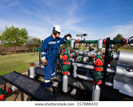 Operator in natural gas industry - stock photo