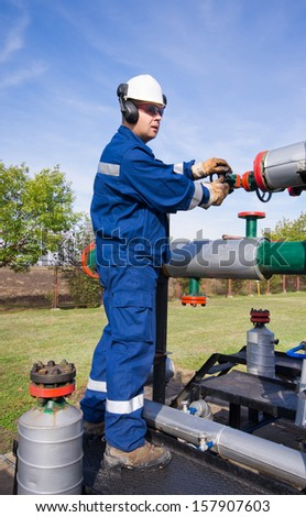 Operator in natural gas production industry - stock photo
