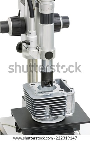 operator inspection machining surface of automotive part by microscope - stock photo
