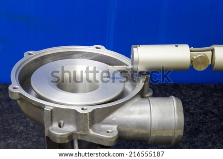 operator inspection turbo machining part roughness by roughness tester machine - stock photo