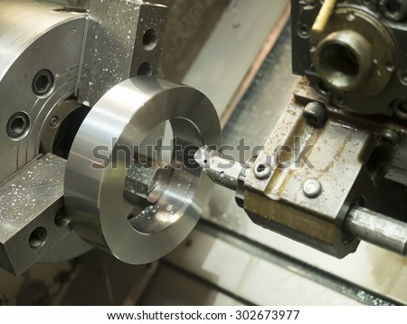 Operator machining mold and die parts for automotive by CNC turning - stock photo