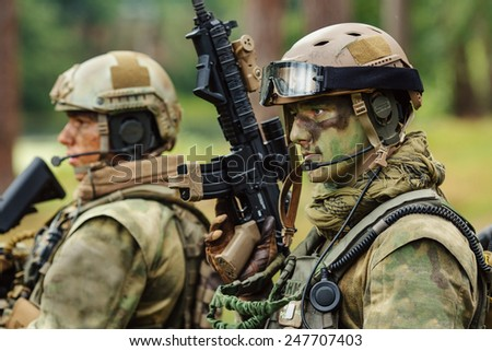operator stands with arms and looks forward - stock photo