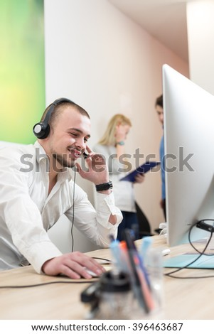 Operator using a computer in a call center - stock photo