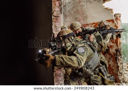 operator warrior stormed the building - stock photo