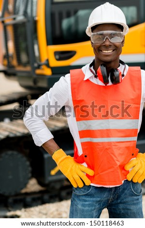 Operator working with a machine at a construction site  - stock photo