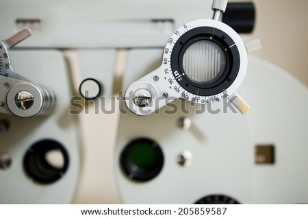 ophtgalmology objects, phoropter vision exam - stock photo