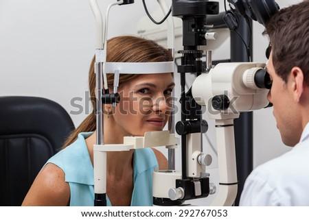 Ophthalmologist doing studies - stock photo