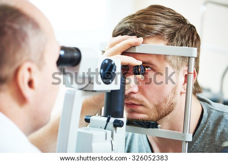 Ophthalmology concept. Male patient under eye vision examination in eyesight ophthalmological correction clinic  - stock photo