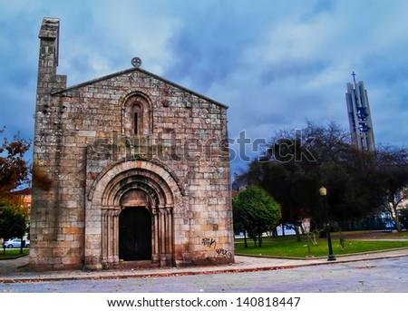 Oporto, December 2012. S���£o Martinho do Cedofeita church. Romanesque style from V or VI century, under germanic Suevi Kingdom. On background, the new church from 1899. - stock photo