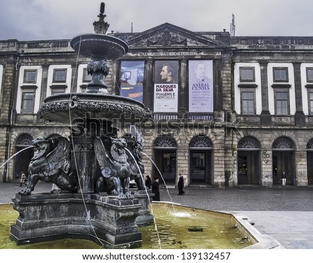 OPORTO, PORTUGAL - DECEMBER 3: Oporto University on December 3, 2012 in Oporto, Portugal. Founded in 1911. One of the 100 bests in Europe. Fountain with winged lions - stock photo