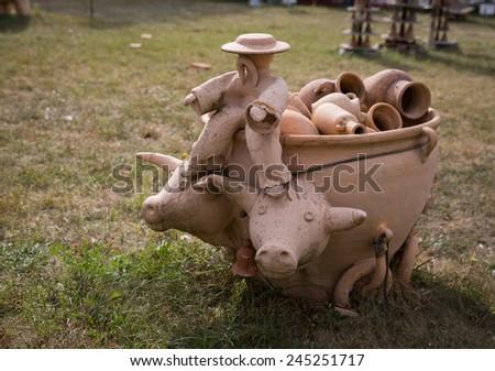OPOSHNYA, UKRAINE-SEPTEMBER 21: Art exhibition of pottery  on september 21, 2014 in Oposhnya, Ukraine. Statue of clay - stock photo