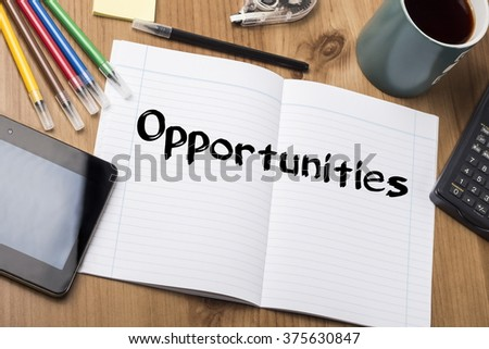 Opportunities - Note Pad With Text On Wooden Table - with office  tools - stock photo