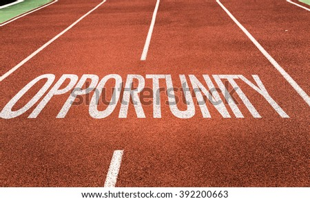 Opportunity written on running track - stock photo
