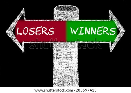Opposite arrows with Losers versus Winners.Hand drawing with chalk on blackboard. Choice conceptual image - stock photo