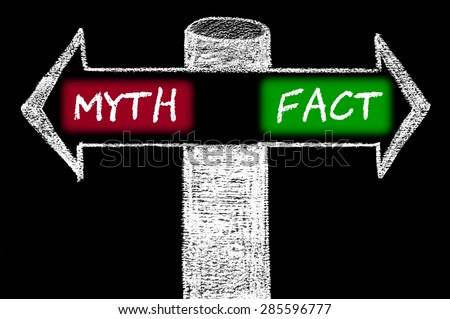 Opposite arrows with Myth versus Fact.Hand drawing with chalk on blackboard. Choice conceptual image - stock photo